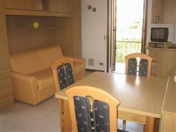 soggiorno - cucina con divano letto